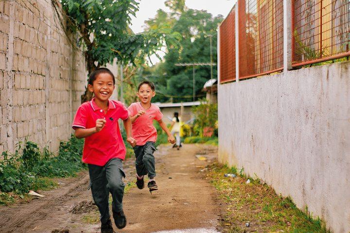 2-asian-boys-running-on-alley-3715315